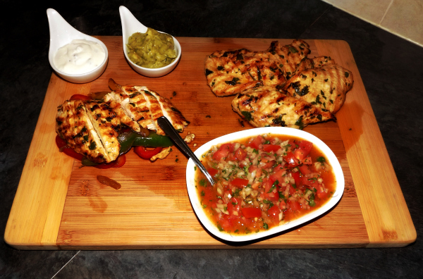 Silent Sunday Fajitas with Salsa guacamole Sour Creme and Chicken breat