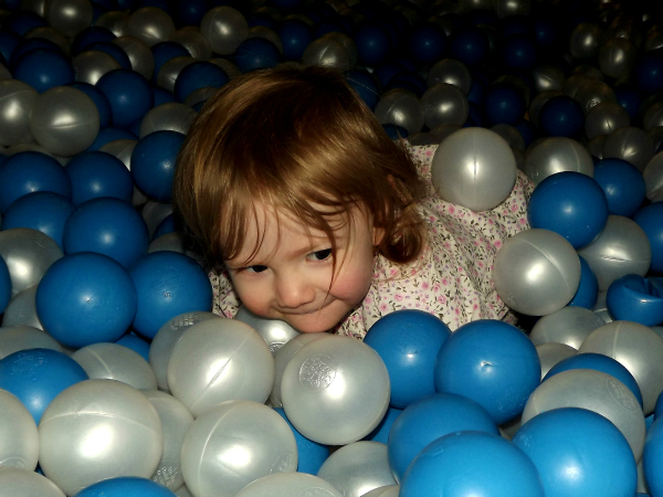 Amy gets to the bottom of the ball pool