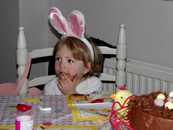 Amy decorating Easter biscuits wearing bunny ears