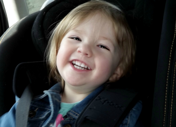 Amy having fun in her car seat