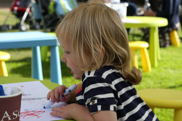 Amy drawing and colouring in at Family Day at Ascot Shergar Cup 2013