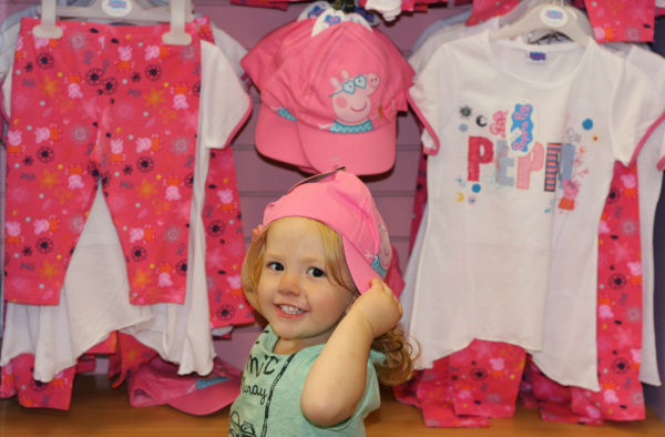 Amy models Peppa Pig clothes at Peppa Pig World at Paulton Park