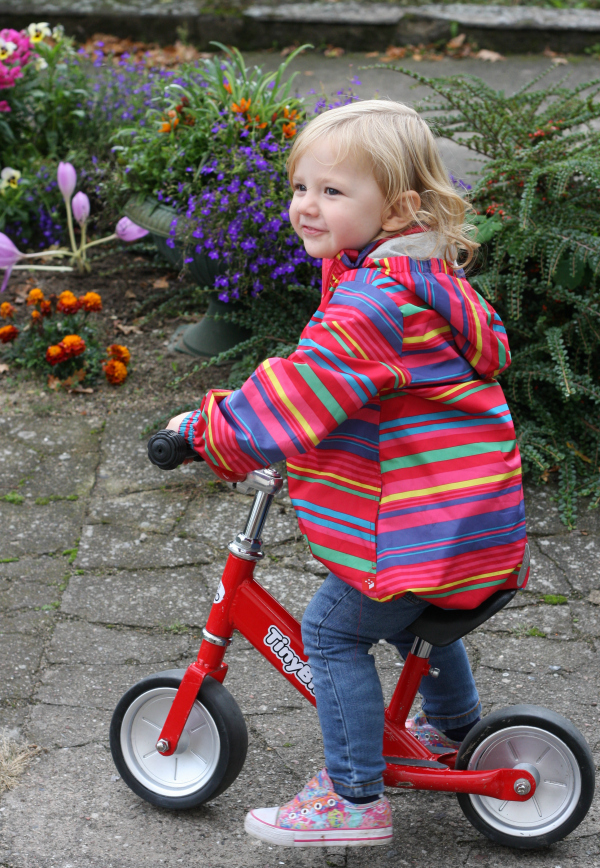 Amy on her balance bike on her way to my grandparents' allotment
