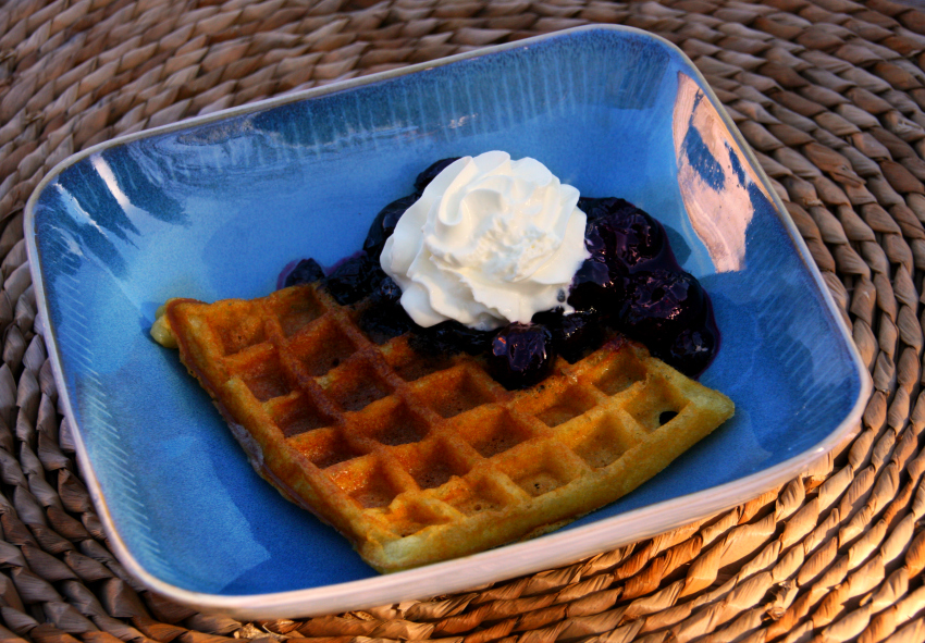 belgian waffles with a sweet cherry and blueberry topping