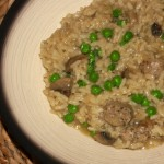 Mushroom risotto with sausages and peas