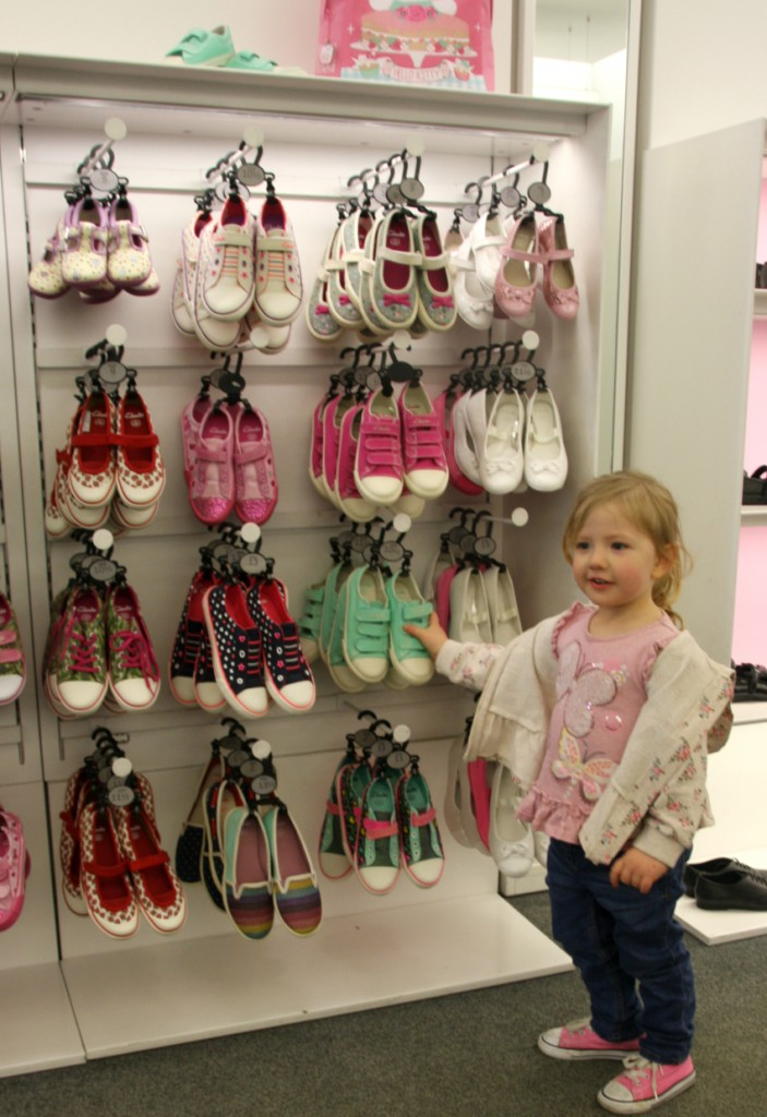 Amy is shopping for girls shoes at clarks