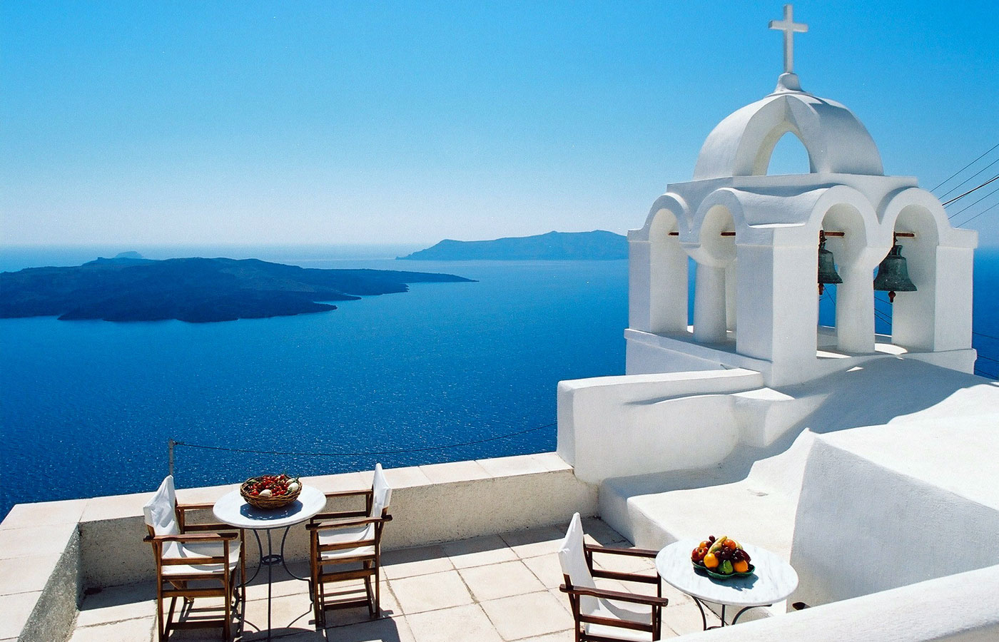Santorini outdoor living, white buildings in front of blue sky