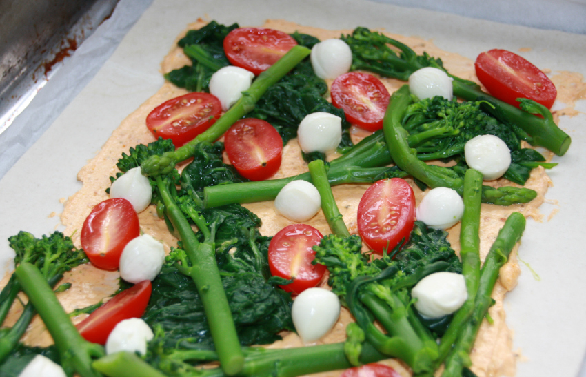 puff pastry pizza with spinach, broccoli and asparagus