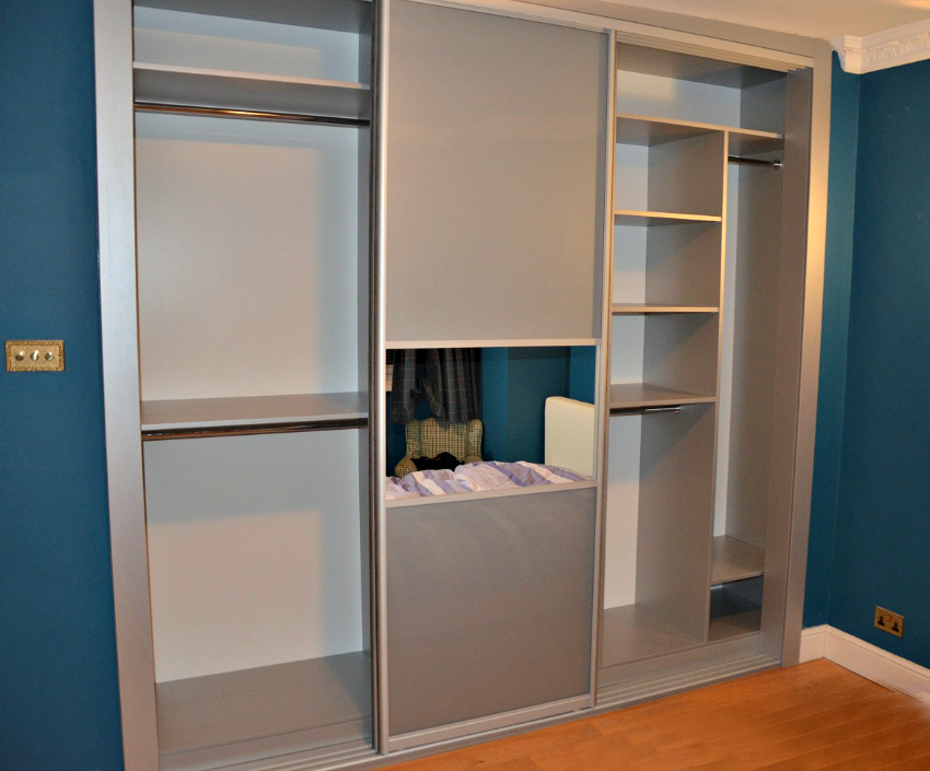use built in furniture or wardrobes with sliding doors as furniture for small spaces